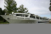The 'Grande Caribe' squeezes into the lock on a fall foliage tour.