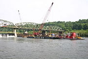 Construction barges working on the spillway.