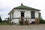 A damaged lockhouse from the floods of 2006.