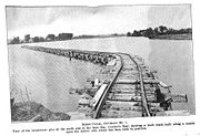 Trestle upon the wooden cribs during construction (1907).